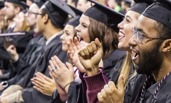 New EKU graduates cheer at Commencement 2018.