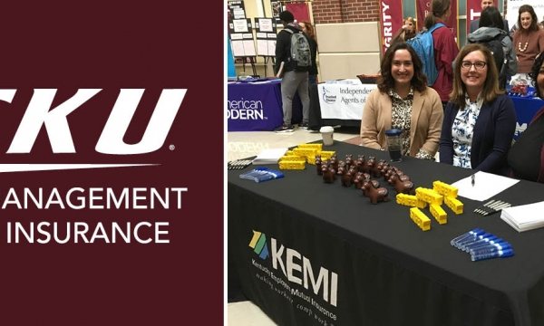 KEMI promotional booth and EKU Risk Management and Insurance logo