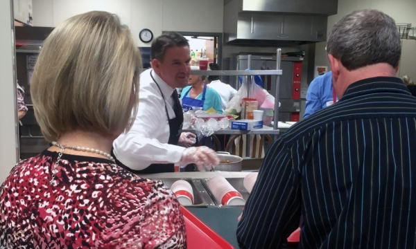 EKU President Benson serves soup to people attending Empty Bowls event.