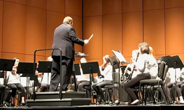 Eric Sokolowski directs the Model high school concert band.