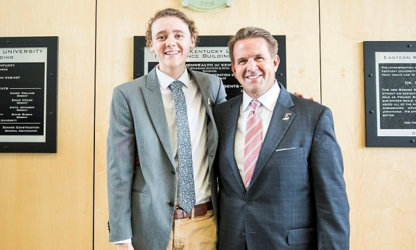 Nick Koenig stands with EKU President Michael T. Benson