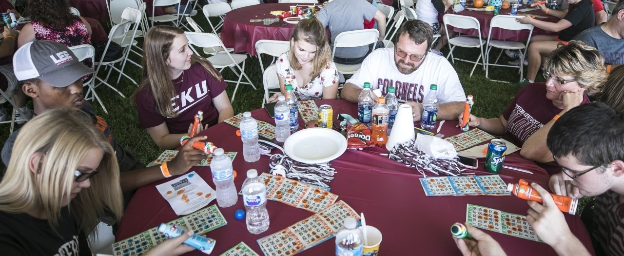 Family playing bingo at 2018 Family Weekend