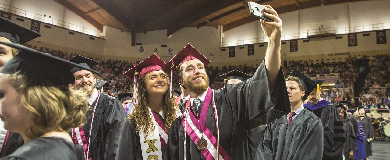 EKU Honors students take a selfie at graduation.
