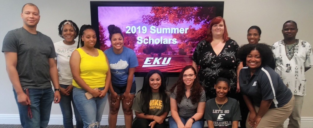 12 of 19 Summer Scholars gathered for a kickoff luncheon May 23