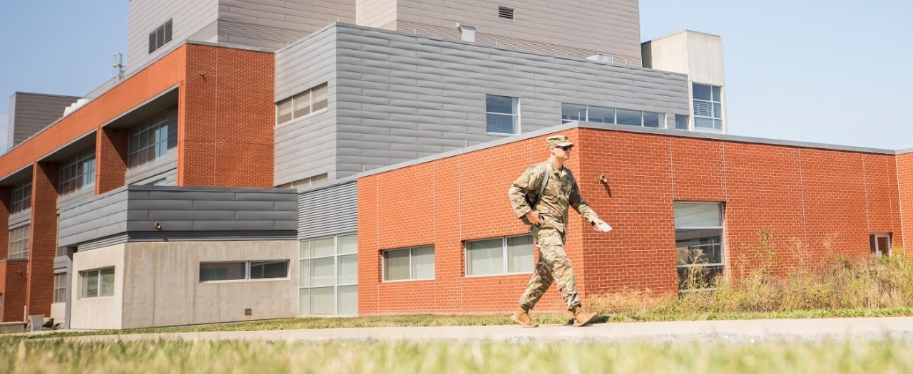 military member walking by the New Science building in uniform