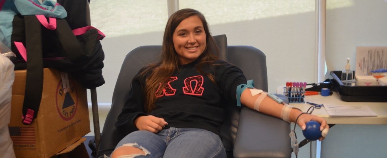 An EKU Colonel gives blood during Greek Week.