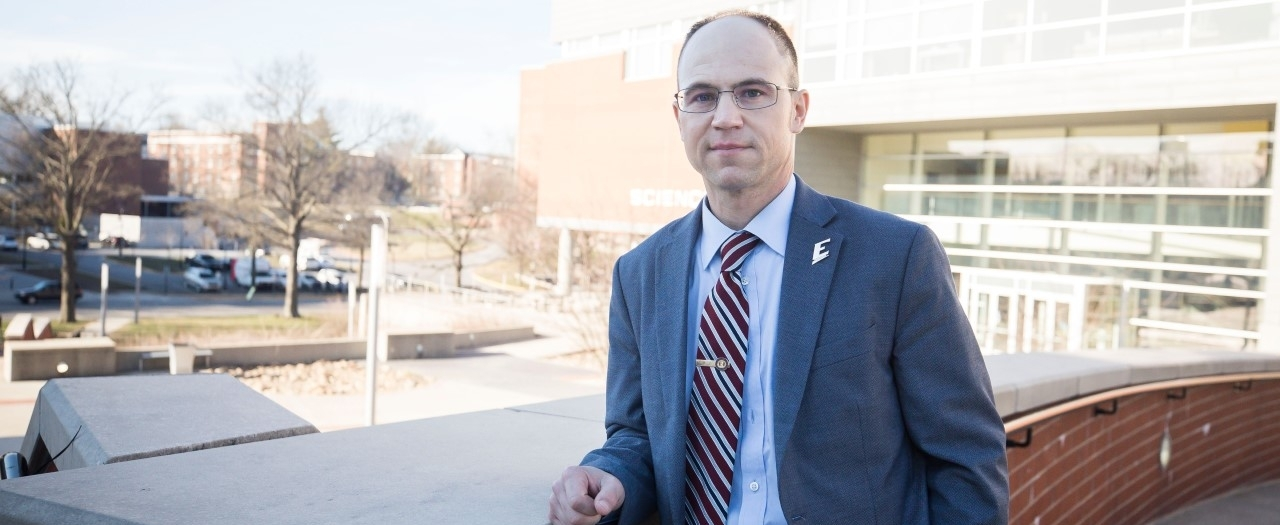 Jason Marion in front of the New Science Building, 2019