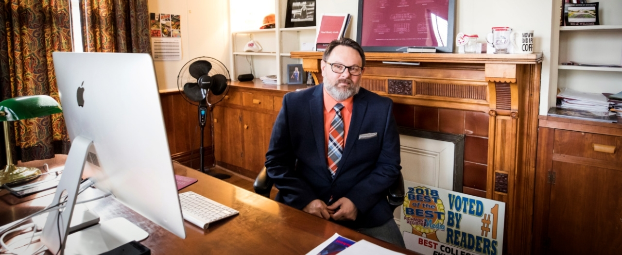 Lanny Brannock sits in an office at the Rice House on EKU's campus.