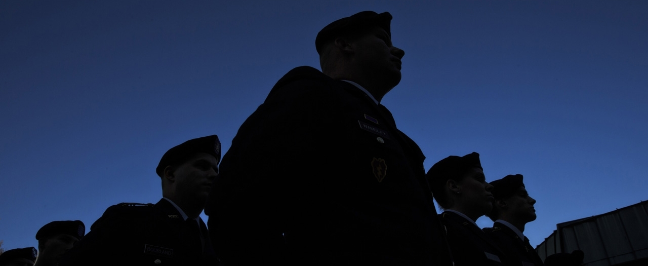 file photo of veterans in silhouette