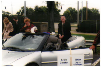 Brian Joyce as an EKU student, preparing to ride in a silver convertible for the Homecoming parade